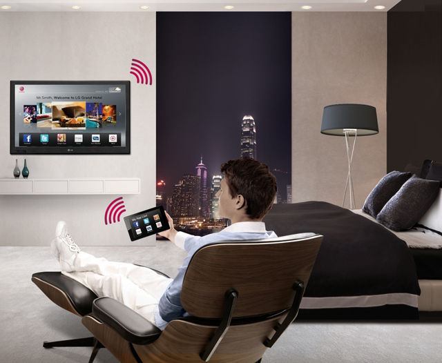a man in a chair using a hospitality hotel tv solution